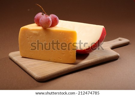 Cheese on wood plank