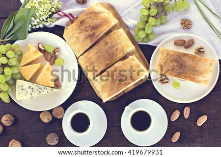 Cheese pie, strudel with cheese, cheese pie 4. Wine, grapes, nuts, cheese, blue cheese, and coffee. dinner, lunch, romantic date, picnic, eating on nature.