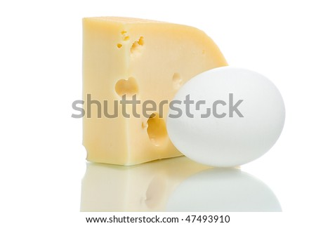 Cheese piece and egg. Isolated on white background.