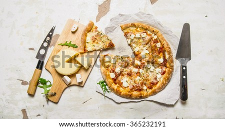 Cheese pizza with herbs and fresh cheese. On rustic background. Top view - stock photo