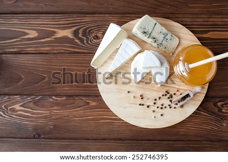 cheese plate with Brie, Camembert, Roquefort - stock photo
