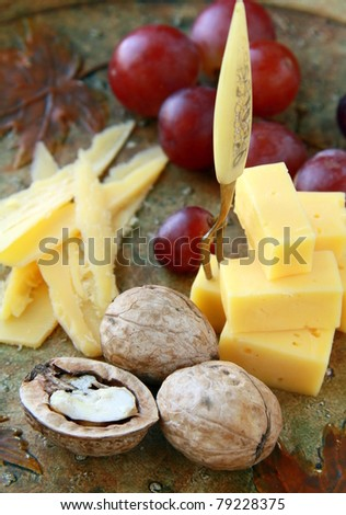 cheese plate with grapes and walnuts