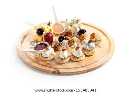 Cheese Plate with Grapes, Nuts, Honey and Berries Sauce - stock photo