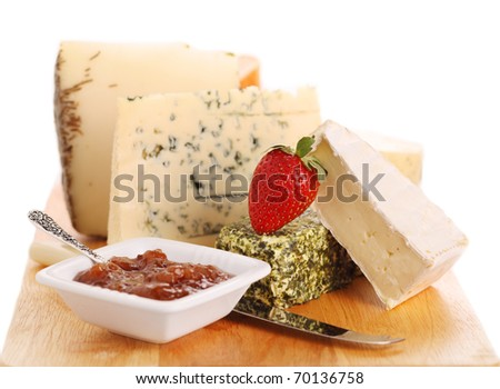 Cheese platte with organic fresh cheese on white isolated background - stock photo