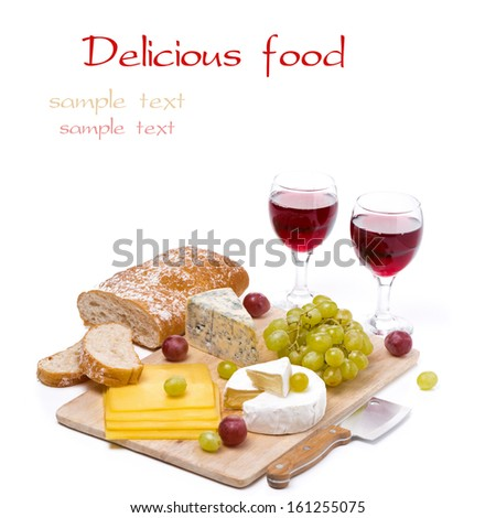 Cheese platter, grapes, ciabatta and two glass of red wine isolated on white