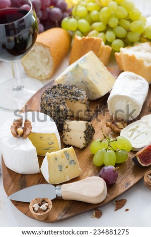 cheese platter, snacks, bread and wine, top view