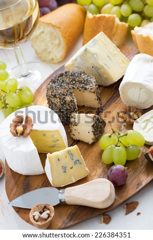 cheese platter, snacks, bread and wine, vertical, top view - stock photo