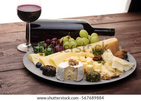 Cheese platter with different cheese and grapes and red wine & Cheese Platter Different Cheese Grapes Red Stock Photo (Royalty Free ...