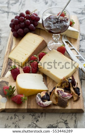 Cheese platter with French cheeses with fruits confiture