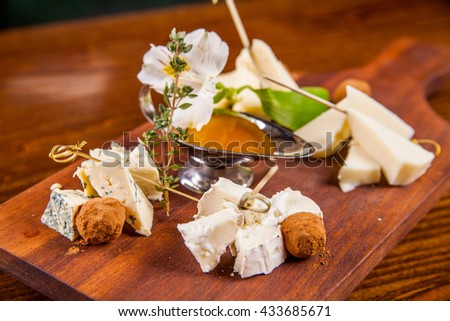 Cheese platter with honey and chocolate truffle