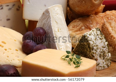 cheese platter with some organic fresh cheese - stock photo