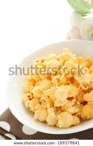 Cheese popcorn on white bowl - stock photo
