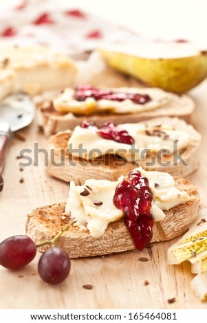 Cheese, roasted bread and ripe green pears - stock photo