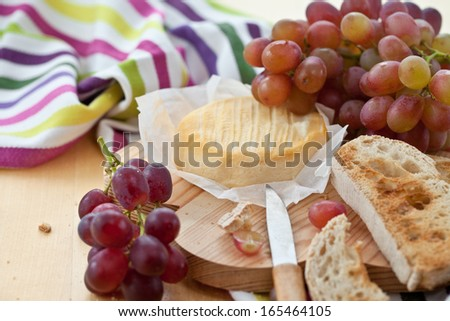 Cheese, roasted bread and ripe red grapes