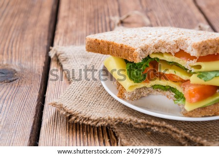 Cheese Sandwich (close-up shot) on vintage wooden background