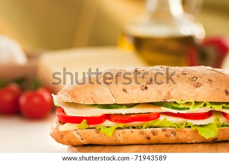 Cheese sandwich with paprika and green lettuce - stock photo