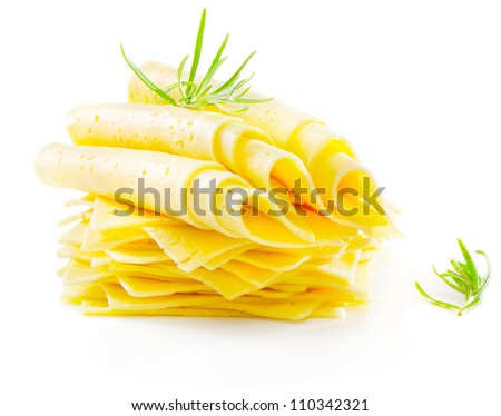 Cheese slices with fresh herbs isolated on white - stock photo