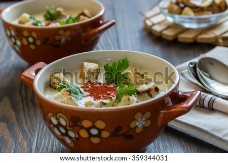 cheese soup puree with croutons and red caviar