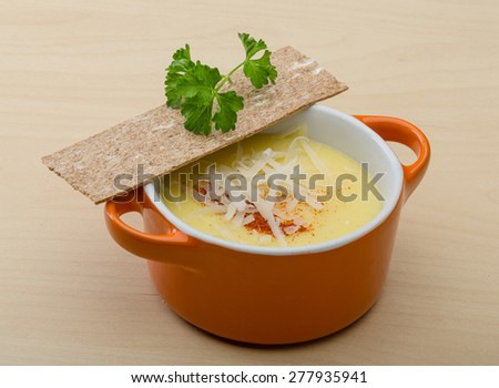 Cheese soup with crutoons and fresh herbs - stock photo