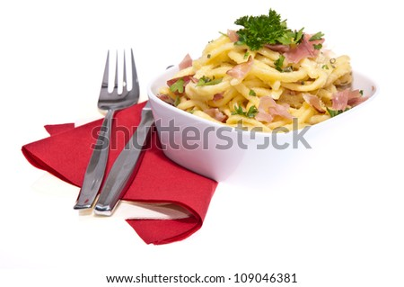Cheese Spaetzle with cutlery isolated on white background - stock photo