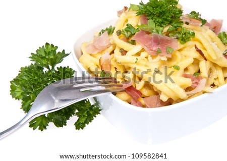 Cheese Spaetzle with fork (macro view) isolated on white background - stock photo