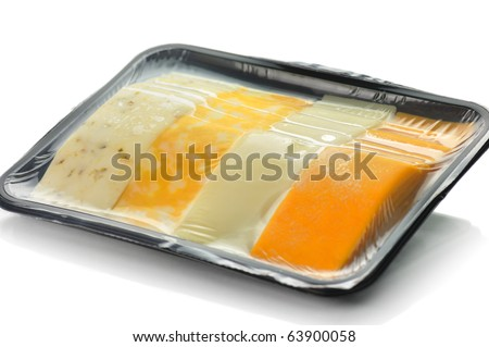 cheese tray slices in a vacuum package - stock photo