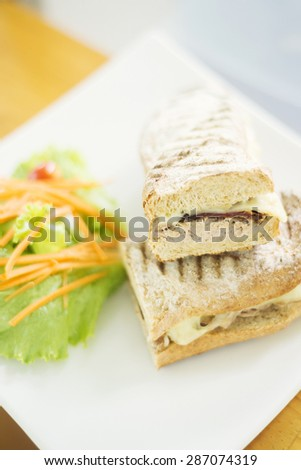 cheese tuna and sundried tomato toasted baguette with salad