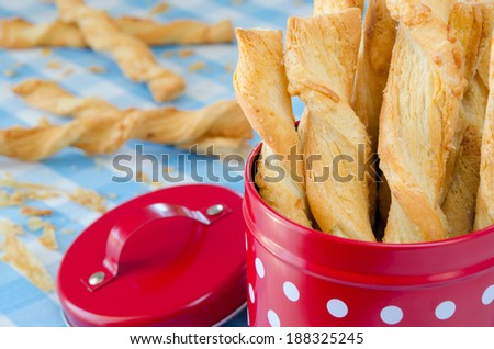Cheese twists placed into a red box. - stock photo