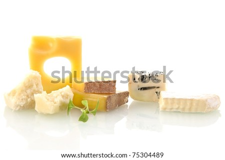 Cheese variation on white background. Emmentaler, parmesan pieces and rockford. Cheese still life. - stock photo