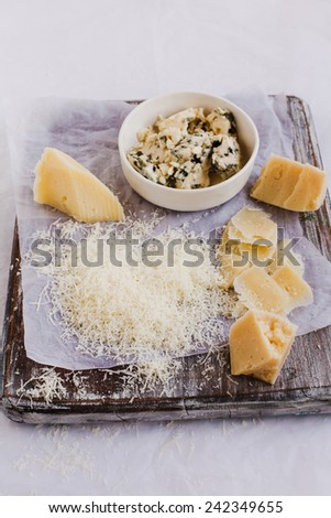 Cheese variety.Food background. Fresh ingredients on a wooden table  - stock photo