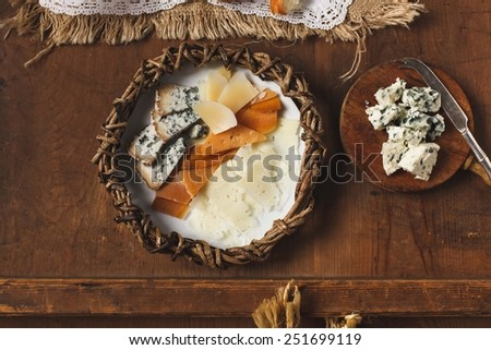 Cheese variety on a vintage background. Food background. Fresh ingredients on a wooden table.  - stock photo