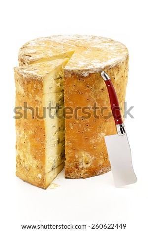Cheese Wheel with Wedge & Knife - stock photo