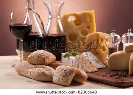Cheese, wine and more on wooden table