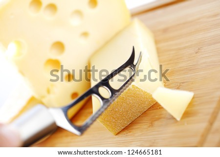 cheese with a cheese knife - stock photo