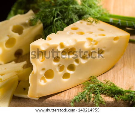 cheese with dill on wooden table - stock photo