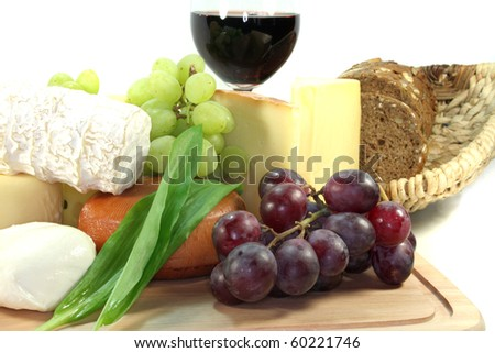 Cheese with fresh grapes, tomatoes and red wine