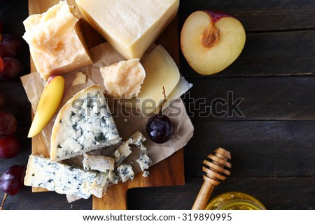 cheese with fruits for appetizer, top view - stock photo