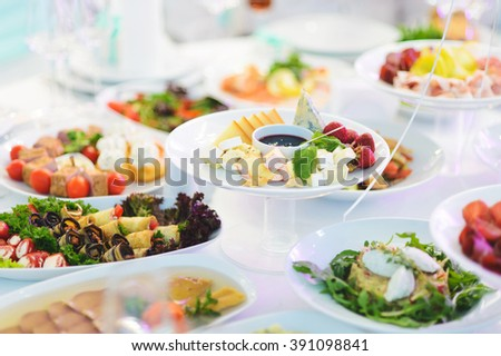 cheese with mint, strawberry and sauce - stock photo