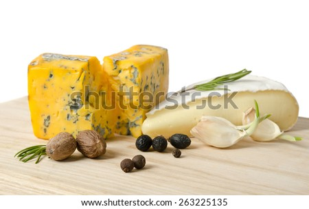 cheese with mold with spice on wooden table - stock photo