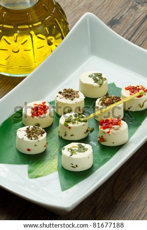 cheese with spices  on wooden background - stock photo