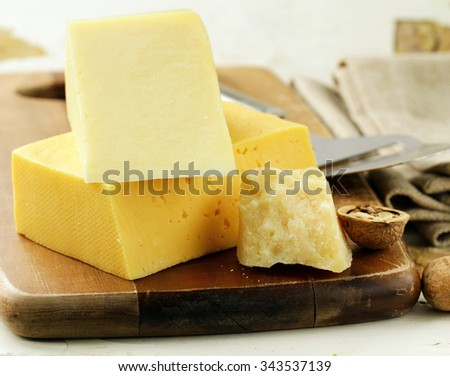 cheeseboard different kinds of cheese for an appetizer - stock photo