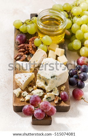 cheeseboard, grapes and wine on a white background, top view