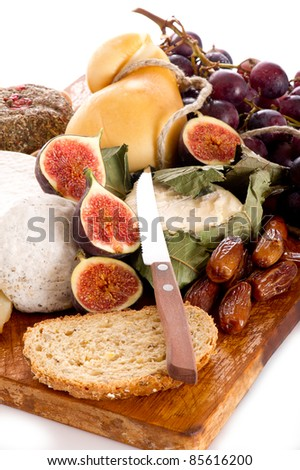 cheeseboard  with an assortment of cheeses  and fruits - stock photo