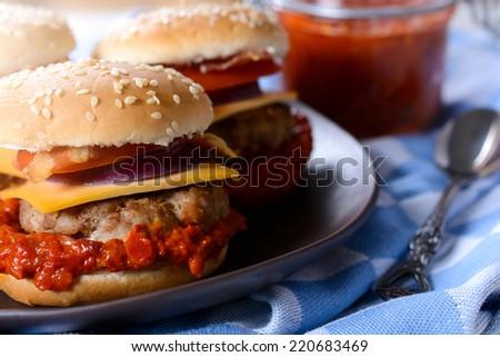 Cheeseburger and ajvar salad,selective focus  - stock photo