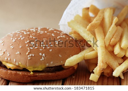 cheeseburger and fries, breakfast - stock photo