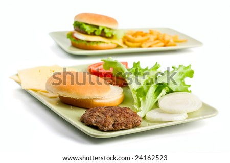 cheeseburger and ingredients for another burger