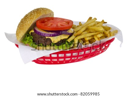 Cheeseburger & french fries in a red basket isolated - stock photo