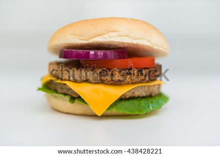 Cheeseburger on a white background.