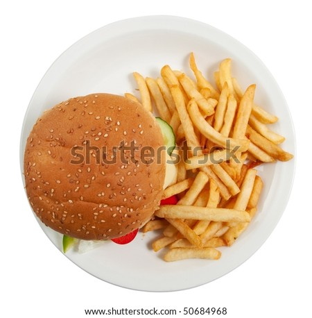 Cheeseburger on dinner plate with french fries isolated on white - stock photo