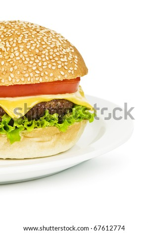 cheeseburger on plate isolated on white - stock photo